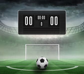 Scoreboard with no score and football — 图库照片