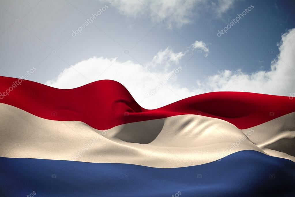 Netherlands Flag Waving Netherlands Flag Waving Against Bright Blue Sky With Clouds Photo by