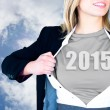 Businesswoman opening shirt in superhero style — Stock Photo
