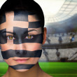 Composite image of beautiful greece fan in face paint — Stock Photo