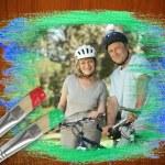Senior couple on bikes in the park — Stock Photo #46752223