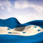Composite image of honduras flag waving — Stock Photo #46752269