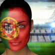 Composite image of beautiful portugal fan in face paint — Stock Photo #46752771