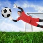 Goal keeper jumping up saving ball — Stock Photo #46752793