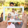 Composite image of hand holding tablet pc — Stock Photo #46754093