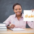 Happy teacher holding page showing students — Stock Photo #46754395