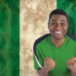 Composite image of cheering football fan in green jersey — Stock Photo #46754431