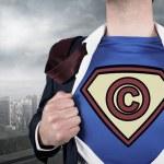 Businessman opening shirt in superhero style — Stock Photo #46755215