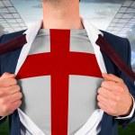 Businessman opening shirt to reveal england flag — Stock Photo #46756477
