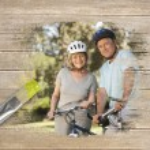Senior couple on bikes in the park — Stock Photo #46756637