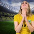 Nervous football fan in brasil tshirt — Stock Photo #46756677