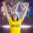 Excited football fan in brasil tshirt — Stock Photo #46757799