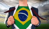 Businessman opening shirt to reveal brasil flag — Stock Photo