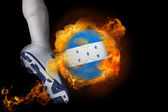 Football player kicking flaming honduras flag ball — Stock Photo