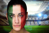 Composite image of beautiful italy fan in face paint — Stock Photo