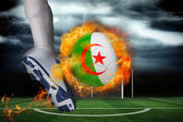 Football player kicking flaming algeria flag ball — Stock Photo
