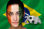 Composite image of ivory coast football fan in face paint — Stock Photo
