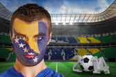 Composite image of serious young bosnia fan with face paint — Stock Photo