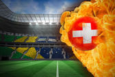 Composite image of fire surrounding switzerland flag football — Stock Photo