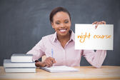Happy teacher holding page showing night course — Stock Photo