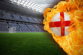 Composite image of fire surrounding england flag football — Stock Photo