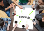 Research on page with people — Stock Photo