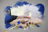 Composite image of groom placing ring on brides finger — Stock Photo