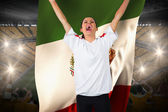 Football fan in white cheering holding mexico flag — Stock Photo