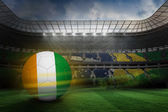 Football in ivory coast colours — Stock Photo