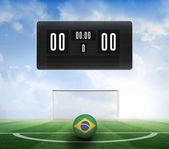 Composite image of black scoreboard with no score and football — Stock Photo