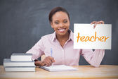 Happy teacher holding page showing teacher — Stock Photo