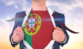 Businessman opening shirt to reveal portugal flag — Stock Photo