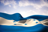 Composite image of honduras flag waving — Stock Photo