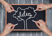 Multiple hands drawing idea tree with chalk — Stock Photo