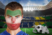 Ivory coast fan with face paint — Stock Photo