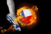 Football player kicking flaming chile ball — Stock Photo