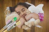 Little girl cuddling teddys — Stock Photo