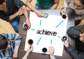 Achieve on page with people around table — Stock Photo