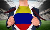 Businessman opening shirt to reveal colombia flag — Stock Photo