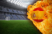 Composite image of fire surrounding spain flag football — Stock Photo