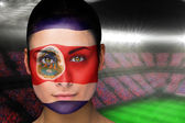 Composite image of beautiful costa rica fan in face paint — Stock Photo