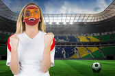 Excited spain fan in face paint — Stock Photo