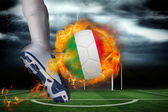 Football player kicking flaming italy flag ball — Stock Photo