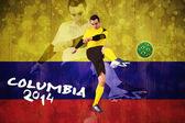 Football player in yellow kicking — Stock Photo