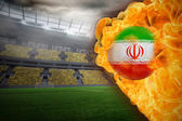 Composite image of fire surrounding iran flag football — Stock Photo