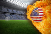 Composite image of fire surrounding usa flag football — Stock Photo