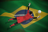 Composite image of fit goal keeper jumping up — Stock Photo