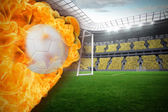 Composite image of fire surrounding football — Stock Photo