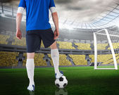 Composite image of football player standing with ball — Stock fotografie
