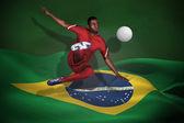 赤い蹴るのフットボール選手の合成画像 — ストック写真